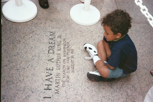 Little boy at the Lincoln Memorial