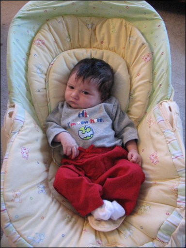 Adriana in her chair, 3 weeks old