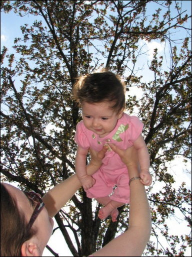 Adriana flying underneath the cherry blossoms