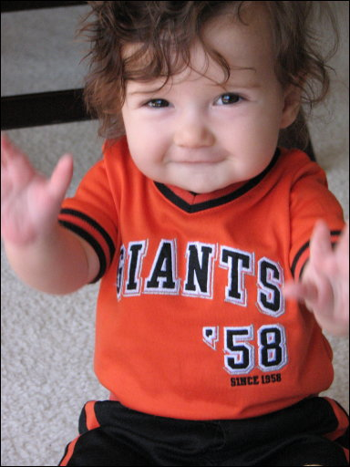 happy baby in a san francisco giants shirt