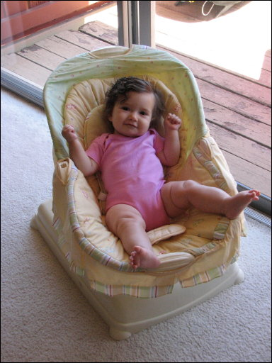 Adriana in her chair, 7 months old